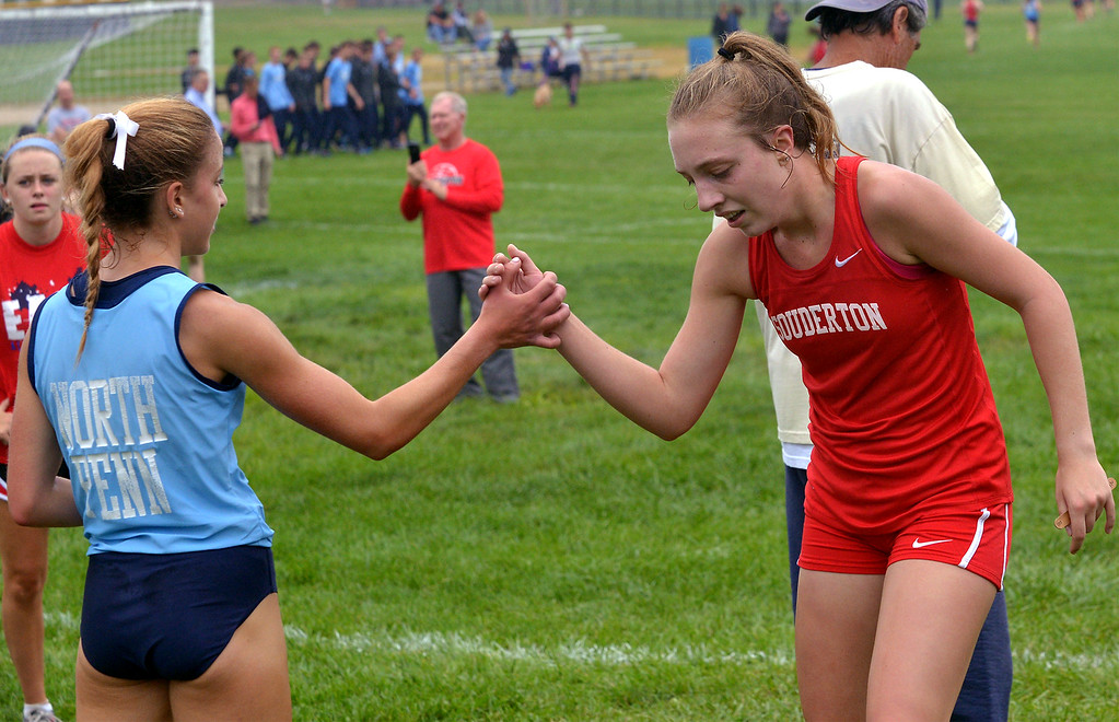 . North Penn\'s Ariana Gardizy welcomes Souderton\'s Emily Bonaventure at the finish of the cross country tri-meet at North Penn High School Sept. 13, 2017. / Bob Raines--Digital First Media