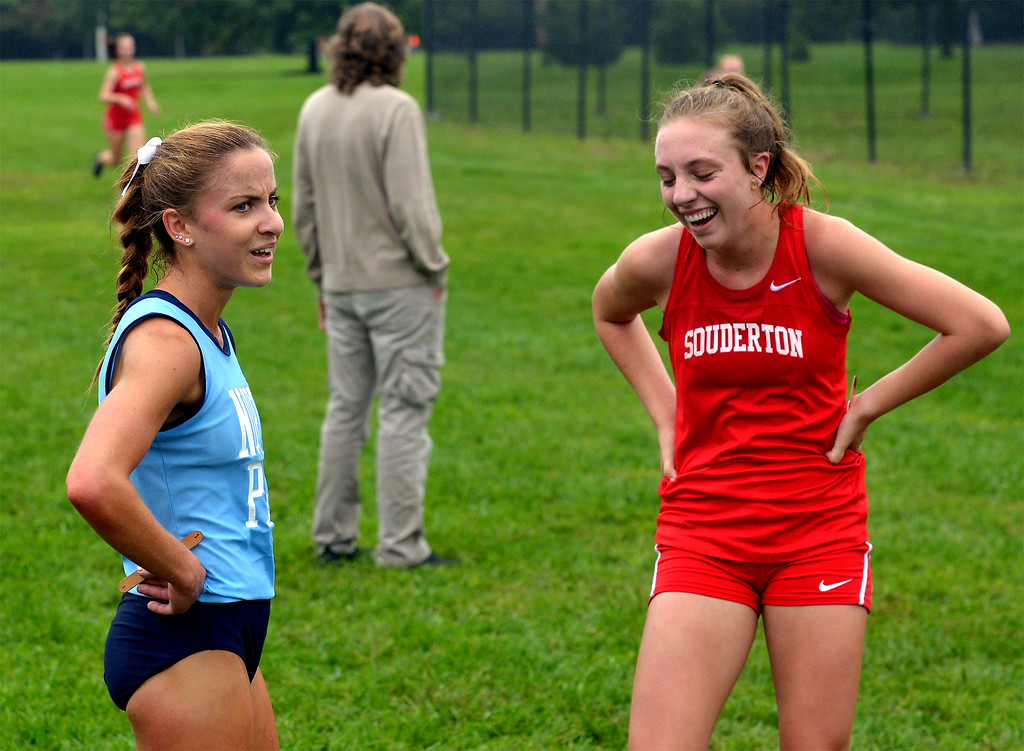 . North Penn\'s Ariana Gardizy and Souderton\'s Emily Bonaventure share a laugh after finishing one and two at the cross country tri-meet at North Penn High School,  Sept. 13, 2017. / Bob Raines--Digital First Media