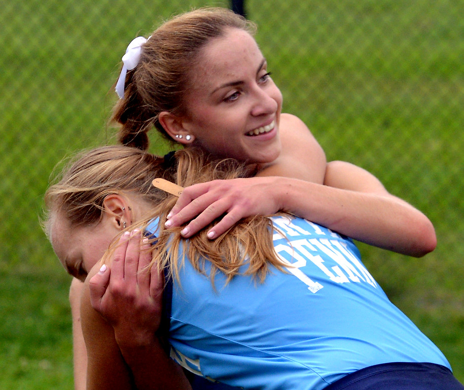 . North Penn\'s Ariana Gardizy steadies teammate Maeve Gimbert at the finish of the cross country tri-meet at North Penn High School, Sept. 13, 2017. / Bob Raines--Digital First Media