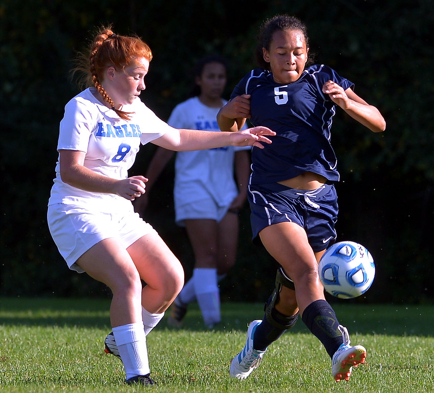 . Pottstown\'s Melissa Coleman gets a pass off past Norristown\'s Emily Schools  Sept. 20, 2017. / Bob Raines--Digital First Media
