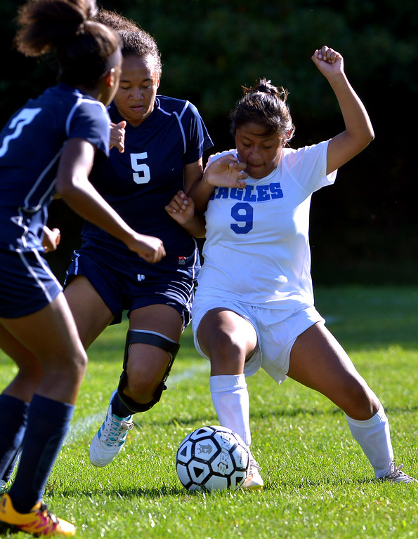 . Pottstown\'s Melissa Coleman and Norristown\'s Jazmin Jimenez battle for the ball Sept. 20, 2017. / Bob Raines--Digital First Media