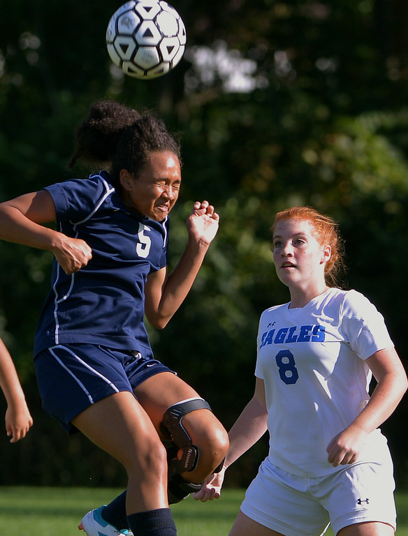 . Pottstown\'s Melissa Coleman beats Norristown\'s Emily Schools to a head ball Sept. 20, 2017. / Bob Raines--Digital First Media