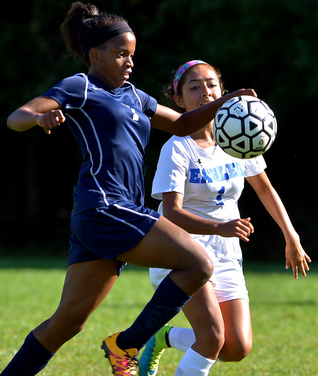 . Pottstown\'s Aniya Hoskins tries to control the ball as she is pursued by Norristown\'s Jessica Lopez Sept. 20, 2017. / Bob Raines--Digital First Media