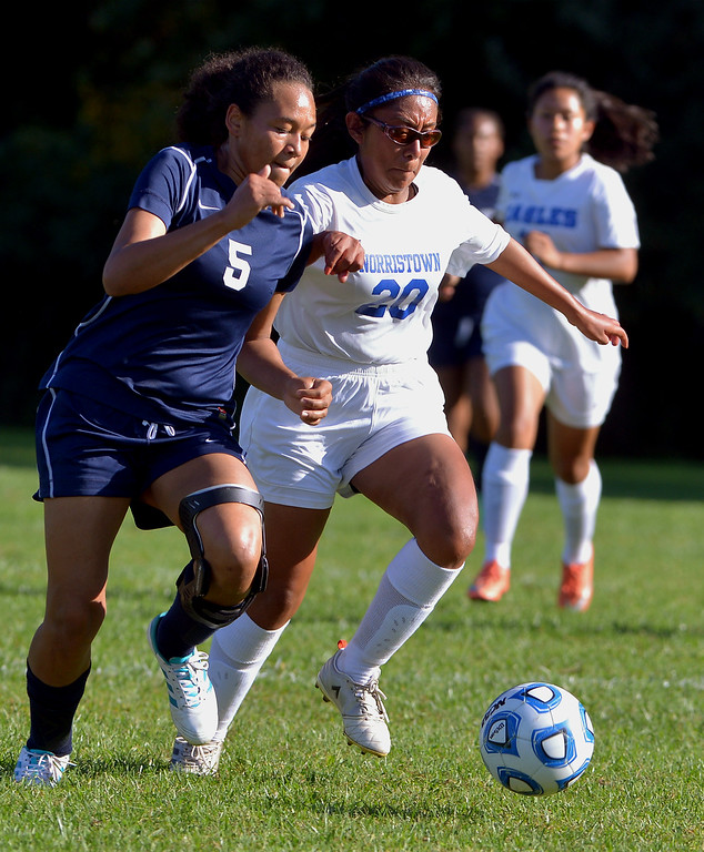 . Pottstown\'s Melissa Coleman and Norristown\'s Sandra Irene race for the ball Sept. 20, 2017. / Bob Raines--Digital First Media