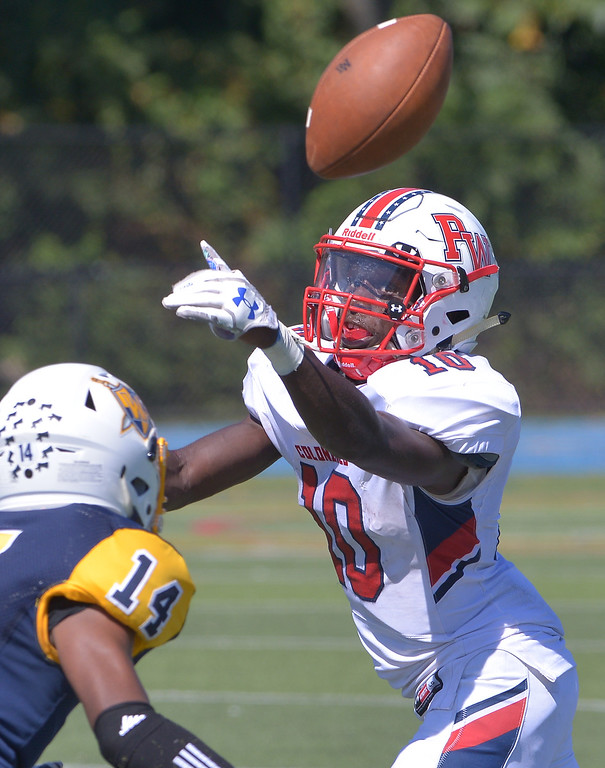 . Plymouth Whitemarsh receiver Dontae Wilson can\'t get a grip on the ball under pressure from Wissahickon\'s Andre Jones Sept. 23, 2017. / Bob Raines--Digital First Media