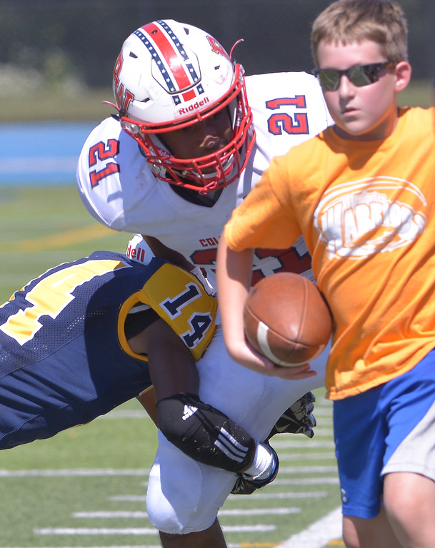 . Plymouth Whitemarsh\'s Kirk Bell gets pushed out of bounds by Wissahickon\'s Andre Jones as ball boy runs for his life Sept. 23, 2017. / Bob Raines--Digital First Media