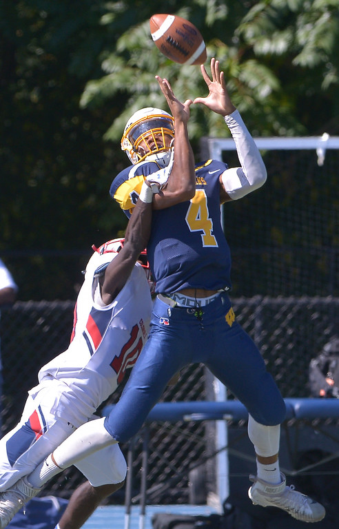. Wissahickon\'s Maurice Willis leaps for a pass but can\'t hang on under pressure from Plymouth Whitemarsh\'s Dontae Wilson Sept. 23, 2017. / Bob Raines--Digital First Media