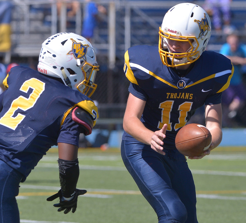 . Wissahickon\'s Nick Santo hands off to Antaun Lloyd during the home game against Plymouth Whitemarsh Sept. 23, 2017. / Bob Raines--Digital First Media