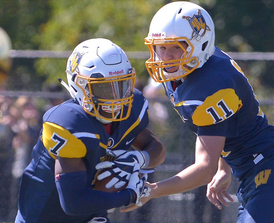 . Wissahickon\'s Nick Santo hands off to Jalen Smalls during the home game against Plymouth Whitemarsh Sept. 23, 2017. / Bob Raines--Digital First Media
