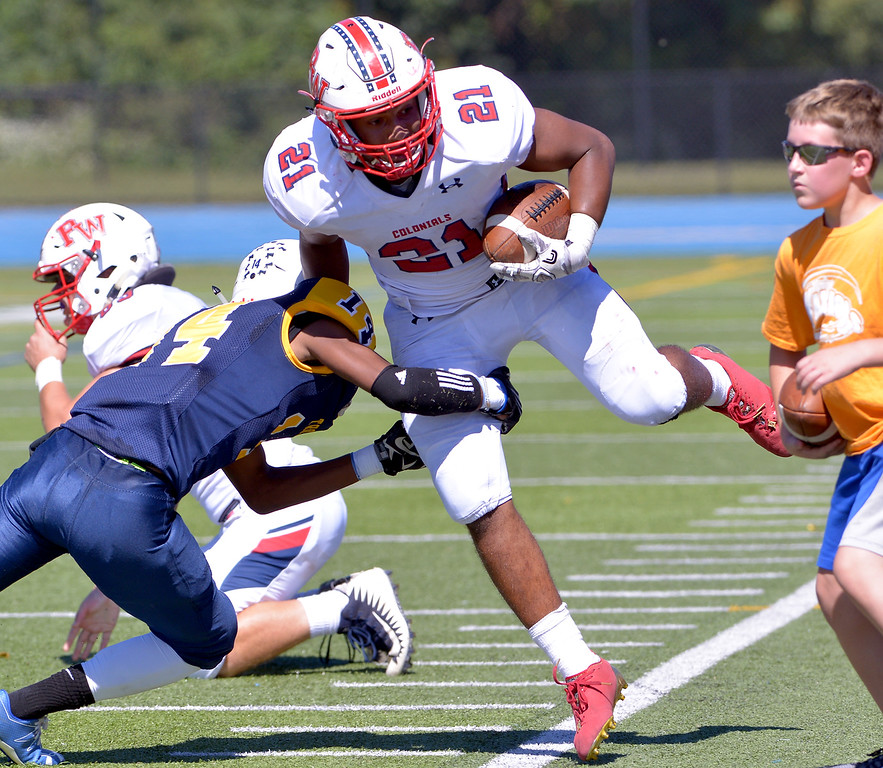 . Plymouth Whitemarsh\'s Kirk Bell gets pushed out of bounds by Wissahickon\'s Andre Jones Sept. 23, 2017. / Bob Raines--Digital First Media