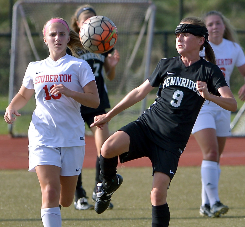. Pennridge\'s Lindsey DeHaven gets ready to boot the ball away from Souderton\'s Taylor Moritz Oct. 10, 2017. / Bob Raines--Digital First Media
