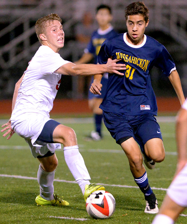 . Hatboro Horsham\'s Colin Bateman tries to stop a drive by Wissahickon\'s Christian Vorchheimer Oct. 10, 2017. / Bob Raines--Digital First Media
