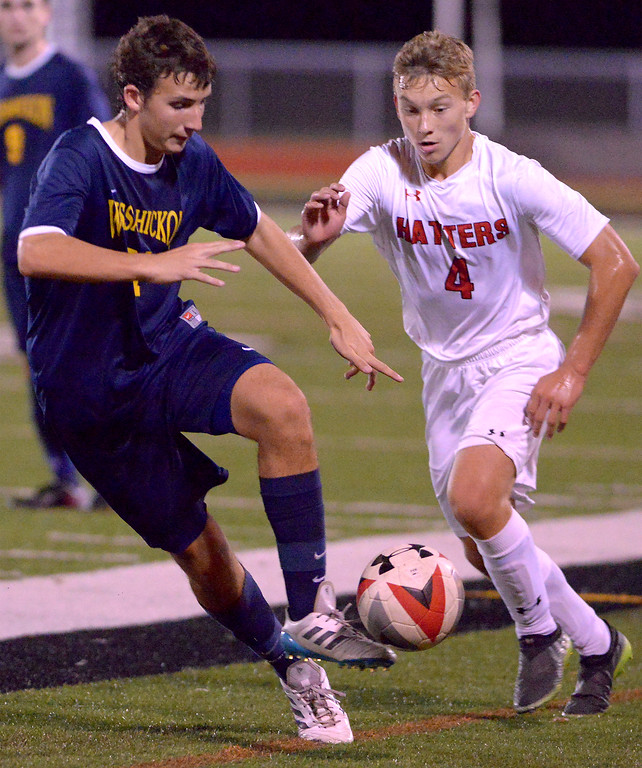 . Wissahickon\'s Trey Schwartz turns the ball up field with Hatboro Horsham\'s Andrew Hurrell in pursuit Oct. 10, 2017. / Bob Raines--Digital First Media