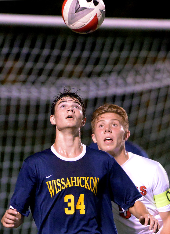 . Wissahickon\'s Jake Cohen gets ready to take a chest ball in front of Hatter Colin Bateman Oct. 10, 2017. / Bob Raines--Digital First Media