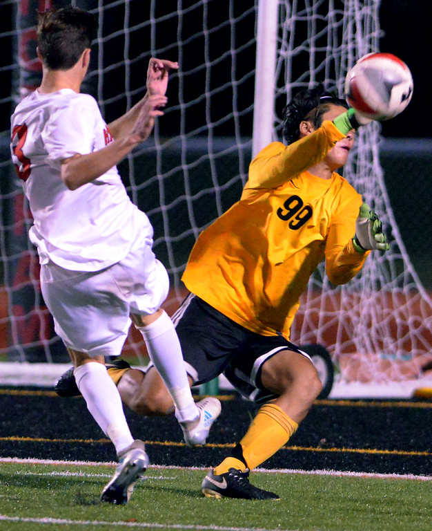 . Wissahickon goal keeper Jun Yuh bats away a shot by Hatboro Horsham\'s Danny Harmon Oct. 10, 2017. / Bob Raines--Digital First Media