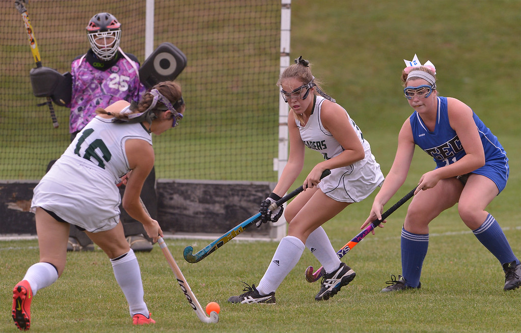 . Lansdale Catholic\'s Julianna Connors drive a shot at Conwell-Egan goal as Lindsay Currie screens Conwell-Egan\'s Bridget Faherty Oct. 11, 2017. /  Bob  Raines--Digital First Media