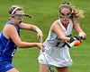 Lansdale Catholic's Lindsay Currie knocks down the ball ahead of Conwell-Egan's Caitlyn McHugh Oct. 11, 2017. / Bob Raines--Digital First Media