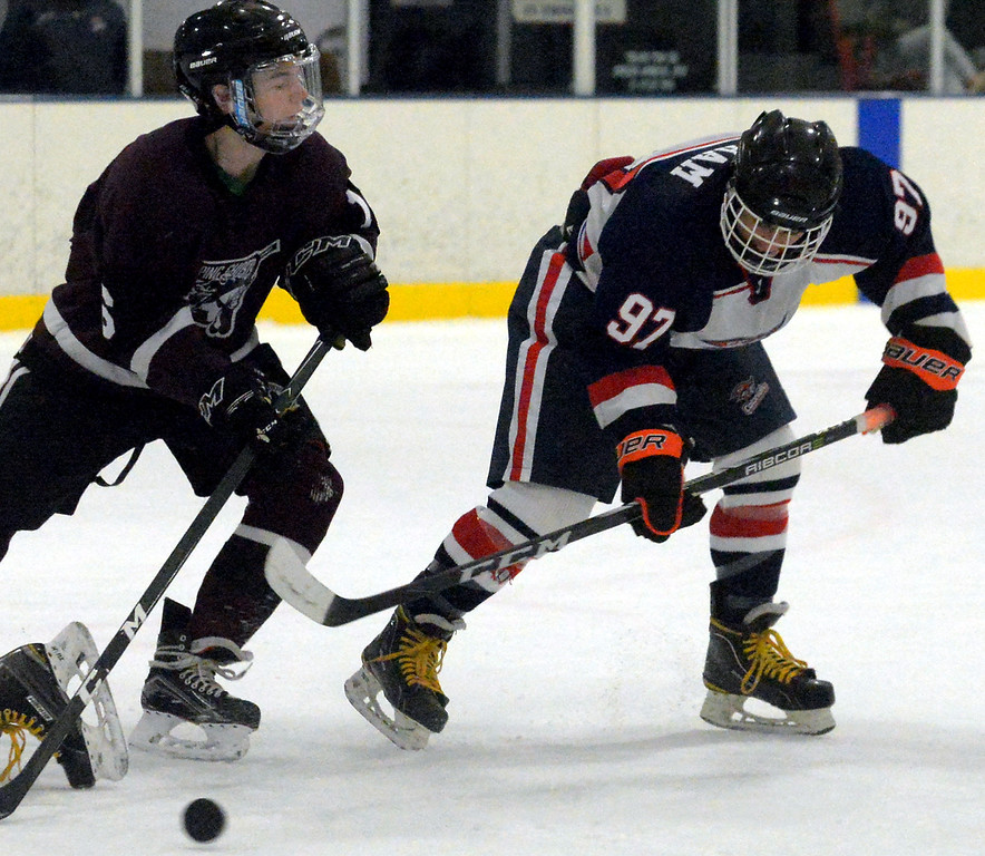 . Plymouth Whitemarsh\'s Brandon Pham backhands a shot past Abington\'s Colin Bruton Dec. 6, 2017. (Bob Raines--Digital First Media)