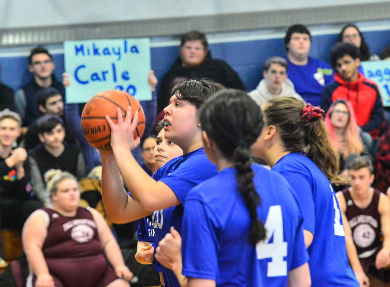 KRISTOPHER RADDER — BRATTLEBORO REFORMER<br /> Hinsdale N.H.'s Mikayla Carle lines up her shot against Fall Mountain Regional School during a unified basketball at the Hinsdale Middle High School on Friday, Jan. 3, 2020. According to the Special Olympics website, Unified Sports is also an integral part of Special Olympics Unified Champion Schools, which was founded in 2008 and funded through the U.S. Office of Special Education Programs at the U.S. Department of Education to use Special Olympics as a way to build inclusion and tolerance in schools.