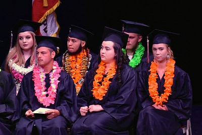 Pensive listening amidst colorful leis at the Pacific Coast High School graduation. (José Quezada—For the Times-Standard)
