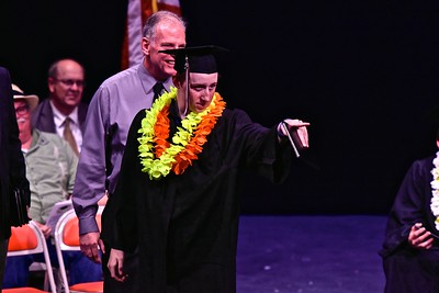 David L. Steele points out to his family cheering for him moments after receiving his Pacific Coast High School diploma Tuesday evening. (Jose Quezada — For Times-Standard)