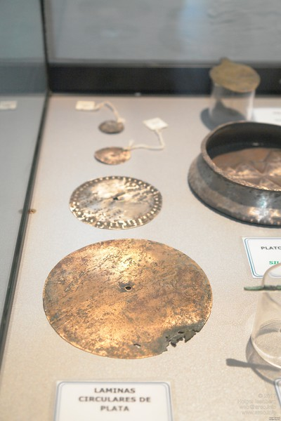 Old metal discs from excavations near Paracas. Paracas History Museum.
