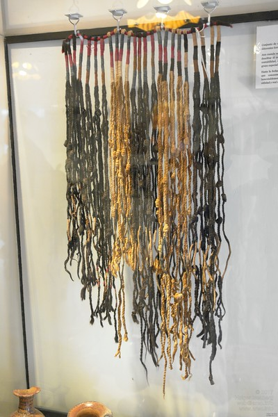 A quipu, the recording or message transportation device for the Inca. Paracas History Museum.