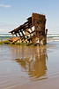 Children frolic at Peter Iredale's rusting hull, Fort Stevens.