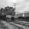 Pacific Electric 1626 with a westbound freight train passes the Arcadia storage tracks in 1949. <br /> <br /> Photographer Frank J Bradford