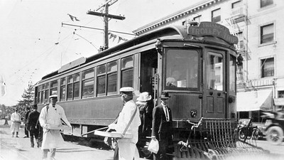 """Pacific Electric deluxe car 025 is seen on Ocean Boulevard in Long Beach with the """"Triangle Trolley Trip"""" in February of 1912.  Photographer Unknown Jeffrey Moreau Collection"""