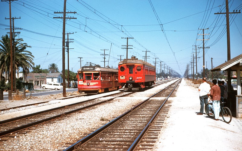Metropolitan Coach Lines 5121 on a fan trip is being passed by 309 on the San Pedro via Dominguez Line. North of Compton, September 16, 1956.<br /> <br /> Photographer Ray Ballash