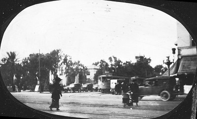 A Pacific Electric 160 series car on one of the Long Beach local lines is about to turn from Pacific Avenue on Ocean Avenue in Long Beach circa 1920. Image from a glass plate negative.  Photographer Unknown Jeffrey Moreau Collection