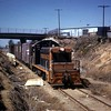 Southern Pacific 1013 powers a local freight on the former Pacific Electric Newport Beach Line in Long Beach in March of 1961.<br /> <br /> Photographer Walter Abbenseth