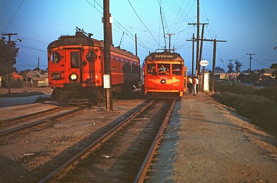 Metropolitan Coach Lines 5111 on a fan trip pauses to let Bellflower Line car 314 pass at Morton on September 26, 1954.  Photographer Ray Ballash