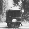 """A zoomed in view of Pacific Electric parlor car 010 """"Agua Mansa"""" as seen on a circa 1912 survey trip. Location Unknown.<br /> <br /> Photographer Unknown<br /> Jeffrey Moreay Collection"""