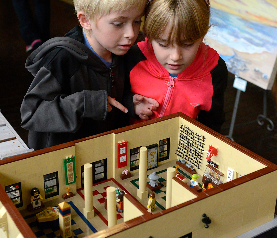 . Twins Carson and Gracie Miller, 7, of Pacific Grove look over a LEGO model of a business during the Pacific Grove Summer LEGO show inside the American Tin Cannery on Saturday July 2, 2016.  (David Royal - Monterey Herald)
