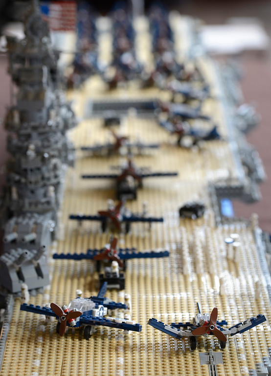 . LEGO airplanescover the flight deck on Marcello De Cicco\'s LEGO model of the USS Yorktown CV10 World War II era aircraft carrier during the Pacific Grove Summer LEGO Show inside the American Tin Cannery on Saturday July 2, 2016. The 8 1/2 foot boat is made up of over 26,000 LEGO bricks and weighs 76 pounds. The event was sponsored by the Bay Area LEGO users group which draws members from as far away as north of San Francisco, east of Oakland and down into Monterey County. (David Royal - Monterey Herald)