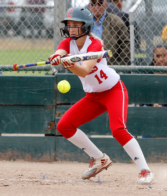 . Carmel High School\'s Rachael Carroll (14) bunts during their game with Pacific Grove High School during their CCS DII softball game in Salinas on Saturday, May 19, 2018.  (Vern Fisher - Monterey Herald)