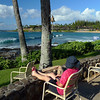 Robyn relaxing at the front of our resort. Napili Bay to the right. there was always a lovely cool breeze here.