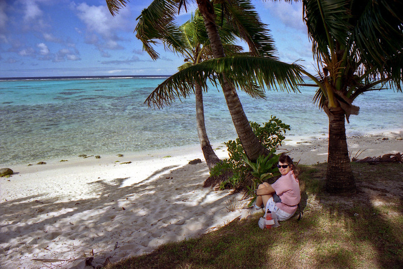 Robyn resting at one of the southern beaches on our bike trip to Muri Beach.