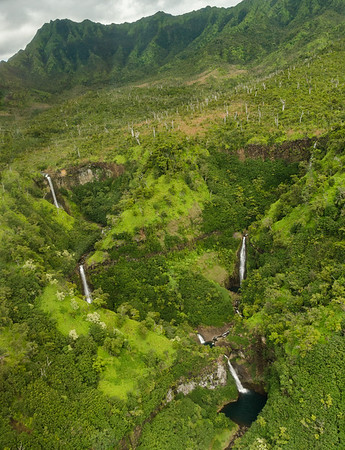 A waterfall-filled aerial view of Kauai