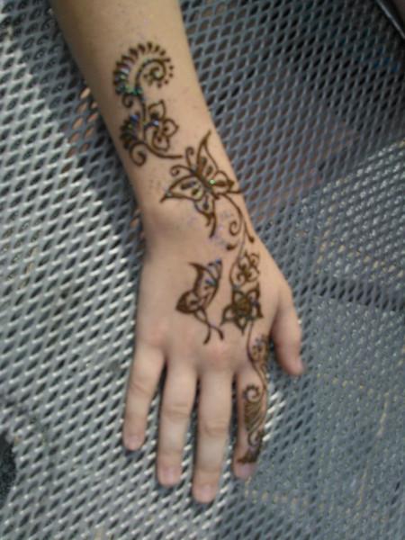May's henna'd arm.