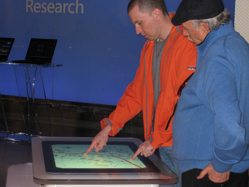People playing with Surface at the Visitor Center.