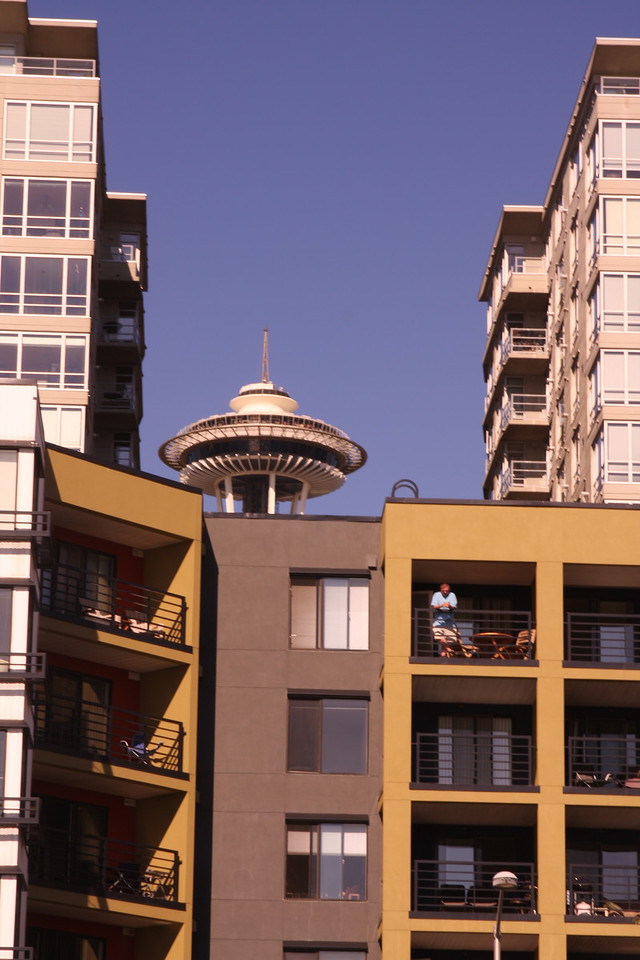 Space Needle peeking through the condos.