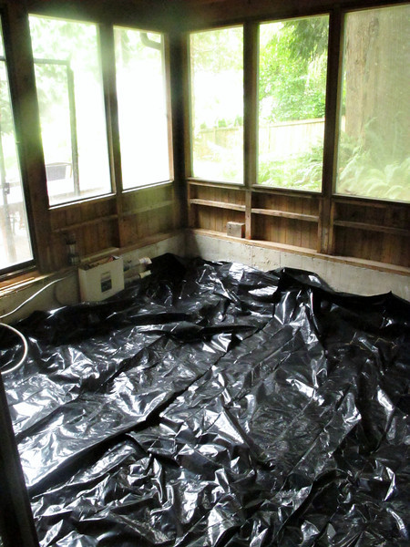 """Not tub"" room - covering up the mess."