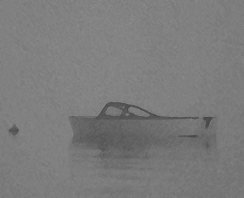 Skiff in fog at ferry terminal