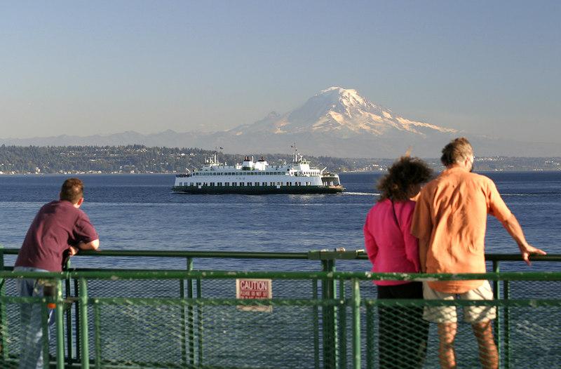 Passengers enjoying a summer ferry ride