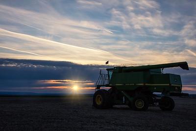 John Deere Combine Sunset