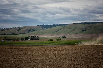 John Deere Tilling Wheat Field