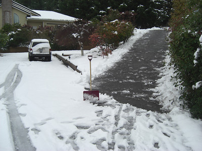 Shoveling. First snow of 2012 melting. Freeland, Whidbey Island. January 20, 2012.
